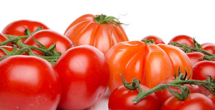 Cluster and beefsteak tomatoes Royalty Free Stock Images