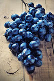 Cluster of Blue Grapes on Old Wooden Background. Stock Photos