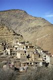 Cluster of buildings on mountainous slope Stock Photo