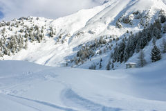 Cluster of chalets on a snowy mountain slope Royalty Free Stock Photos