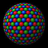 Cluster of colored spheres forming a larger one. A cluster of red, green and blue (RGB) spheres forming a larger fractal sphere on black background Royalty Free Stock Images