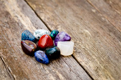 Cluster of colorful healing crystals on textured wooden backgrou Royalty Free Stock Images
