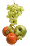 Cluster of grapes, apple and tange Royalty Free Stock Photos