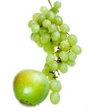 Cluster of grapes in water drops and apple Royalty Free Stock Photos
