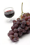 Cluster grapes and wineglass Stock Image