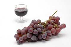 Cluster grapes and wineglass Royalty Free Stock Photos