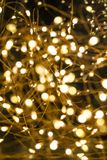 Cluster of micro LED string lights. Shallow depth of field, out of focus blurred.  royalty free stock photography