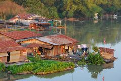 Cluster of the old Houseboat in the river. Way of life at Houseboats in countryside of Thailand stock images