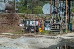 Monroe, Georgia/USA-3/23/17 Discard gas pumps. A cluster of old vintage gas pumps discarded in a abandoned lot with other petroleum equipment rusting away on a stock photo