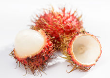 Cluster of peeled rambutan fruits isolated on white   background. Cluster of peeled rambutan fruits isolated on white background Royalty Free Stock Images