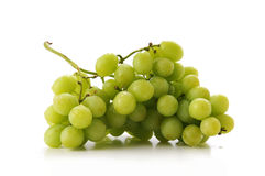 Cluster pf Green Grapes. Cluster of green grapes isolated over a white background Royalty Free Stock Photo