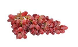 Cluster of pink grapes. On a white background Royalty Free Stock Images