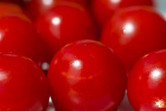 Cluster of red cherry tomatoes Stock Image