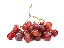 A cluster of red grapes isolated on white background Stock Photo