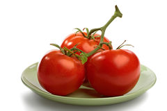 Cluster of red tomatoes with branch Royalty Free Stock Photo