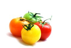 Cluster of red yellow orange and green tomatoes Stock Images