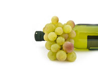 Cluster of ripe grapes and wine bottle Royalty Free Stock Photos