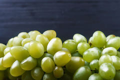 Cluster ripe grapes at wooden board Royalty Free Stock Photography