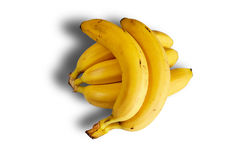 The cluster of ripe large bananas lies on white background with shadow Royalty Free Stock Photo