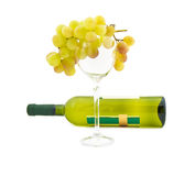 Cluster of ripe muscat grapes and wine bottle Royalty Free Stock Photo