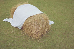 Cluster of straw with white fabric in vintage style Stock Photos