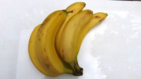 Bananas on white background. Cluster of sweet ripe bananas on a white background. Healthy fruits Sweet fruits. Healthy breakfasts Tropical fruits. Bananas and royalty free stock photos