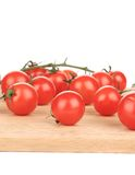 Cluster of Tomatoes on wooden platter Stock Photos