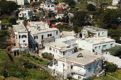 Cluster of  white houses in Capri, Italy. Houses on a hill in Capri, Italy Royalty Free Stock Images