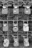 Clustered gas electric meters against brick building royalty free stock photo