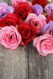Clustered roses on wood Stock Photo