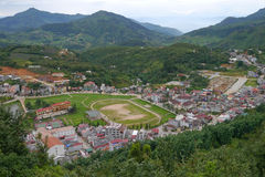 Clusters of buildings nestled in valley at Sapa. Aerial view of clusters of buildings nestled in valley at Sapa, Vietnam Royalty Free Stock Photo