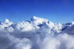 Clusters of white clouds in the sky stock photos