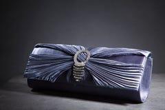 Clutch bag in an elegant design Stock Photos