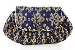 Clutch bag embroidered with beads. Isolated on white Royalty Free Stock Photo