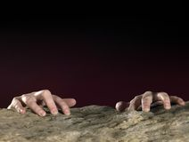 Clutchin hands on stone surface Royalty Free Stock Photography