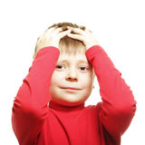 Clutching head. Boy in red clutching head photo over white stock photography
