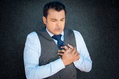 Clutching test tightly, chest pain Stock Photography