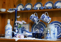 Clutter Of China On Kitchen Dresser Stock Photo