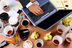 Cluttered Businessman's Desk Stock Photography