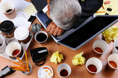 Cluttered Businessman's Desk Stock Images