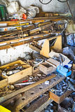 Cluttered junk room. A view of a dirty, cluttered and disorganized junk room Royalty Free Stock Image