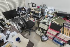 Cluttered Messy Business Office with File Boxes. Cluttered messy business office with full file boxes and notebooks stock photography