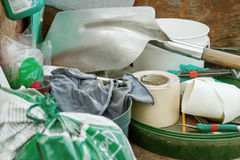 Cluttered and messy storage of garden tools Stock Photo