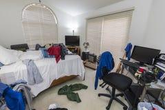 Cluttered Upaćkana chłopiec sypialnia obrazy royalty free