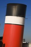 Clyde funnel. Sunlit funnel from a steamship in red, white and black stock photos