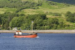 Clyde puffer. A traditional 'clyde puffer' steams down the Kyles of Bute, Scotland, on a summer day stock photography