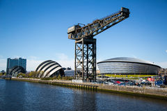 The Clydeside, Glasgow, Scotland, UK. The Clydeside in Glasgow. The old Finnieston crane still dominates the scene with the new SSE Hydro and Armadillo building Royalty Free Stock Photo