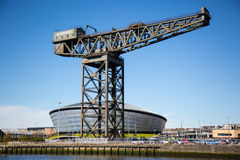 The Clydeside, Glasgow, Scotland, UK. The Clydeside in Glasgow. The old Finnieston crane still dominates the scene with the new SSE Hydro behind Stock Images