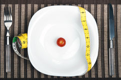 Cm ruler on food plate Royalty Free Stock Photography