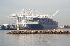 Known as the Benjamin Franklin; one of the largest cargo container vessels. Largest vessel to call the United States ..Cargo container docked in the port of Royalty Free Stock Photography